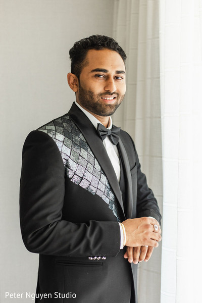 Raja in black tuxedo with blue details.
