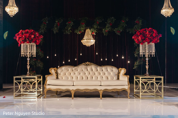 Stage decorated with chandeliers and flowers for photo session.