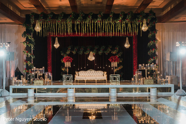 Stage decorated with flowers and candles for photo session.