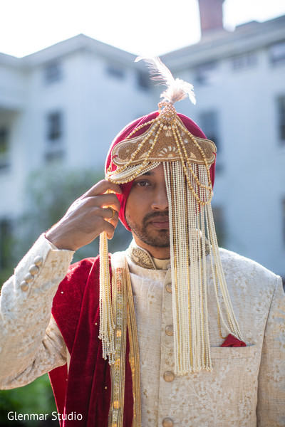 Indian groom posing for pictures prior to the ceremony.