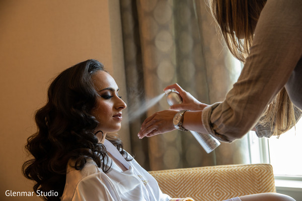 Maharani being assisted by hair and makeup artist.