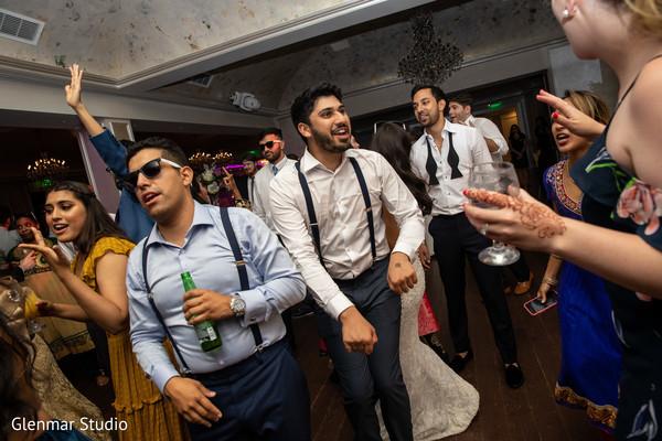 Indian wedding guests on the dancefloor.