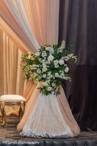 Indian wedding mandap draping and flowers decorations.