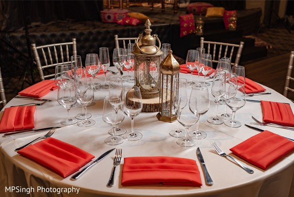 Sangeet table centerpiece bronze lanterns decor.
