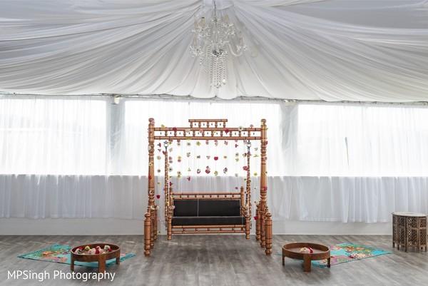 Indian wedding bronze swing seat decoration.