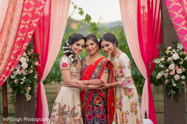 Indian bride's mother with bride and bridesmaid capture.
