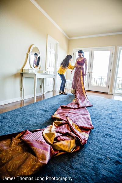 Maharani being assisted with saree prior to the ceremony.