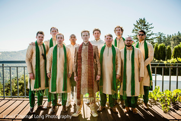 Indian groom with groomsmen posing for pictures.