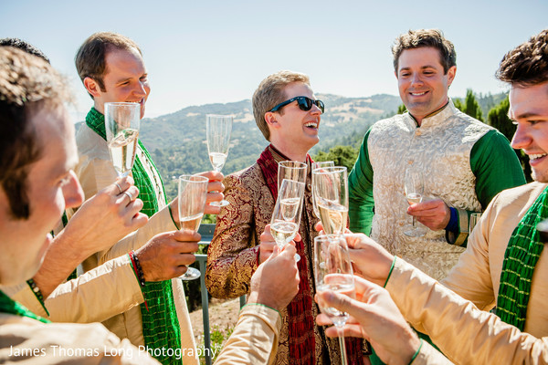Indian groom during toasts with groomsmen.