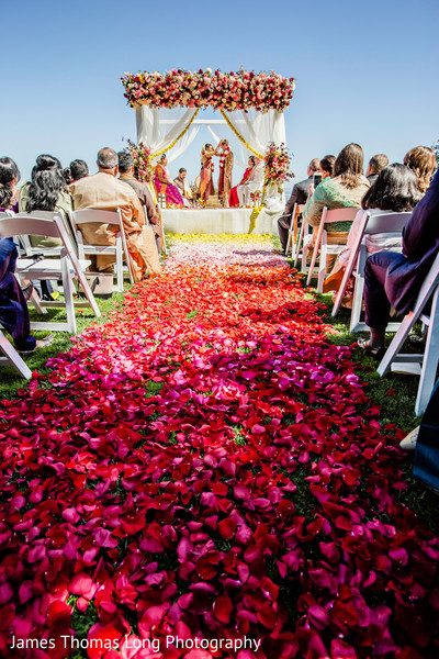 Flower petals decorating the path to the aisle.