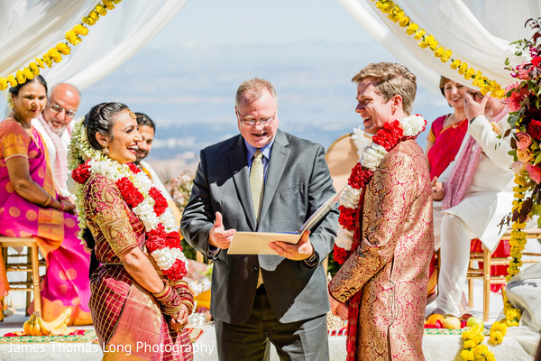 Indian groom and Maharani having a laugh during the ceremony.