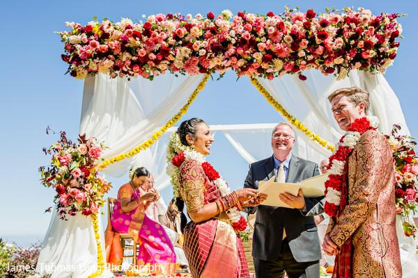 Incredible pink roses decoration for Indian wedding mandap.
