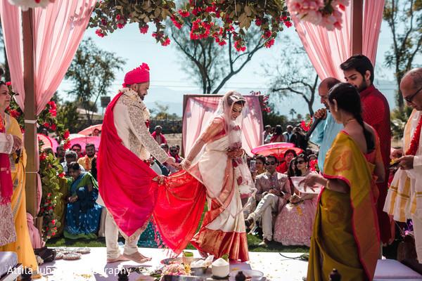 Indian couple walking on the hindu wedding altar.