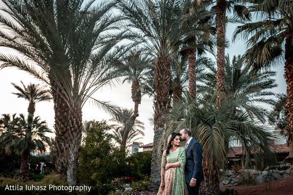 Indian couple in formal wear outdoors picture.