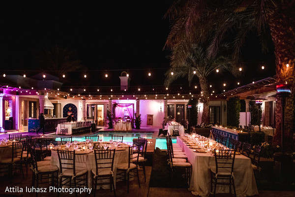 Tables arranged around the pool.