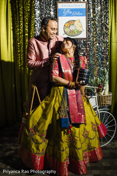 Indian bride and groom posing for pictures during Sangeet.