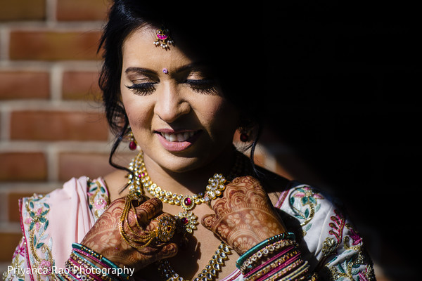 Maharani posing with the jewelry and mehndi design.