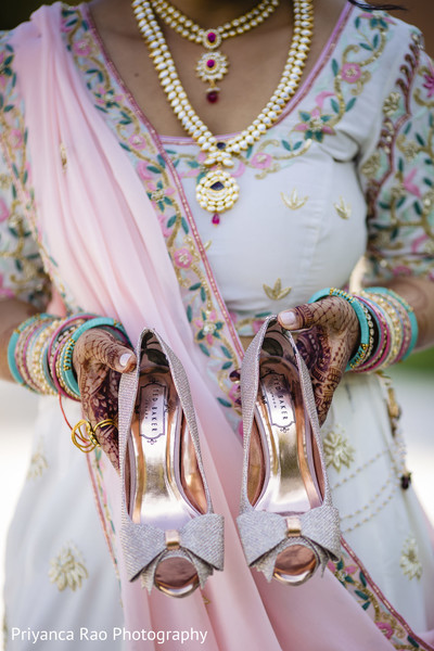 Indian bride's shoes and saree design.
