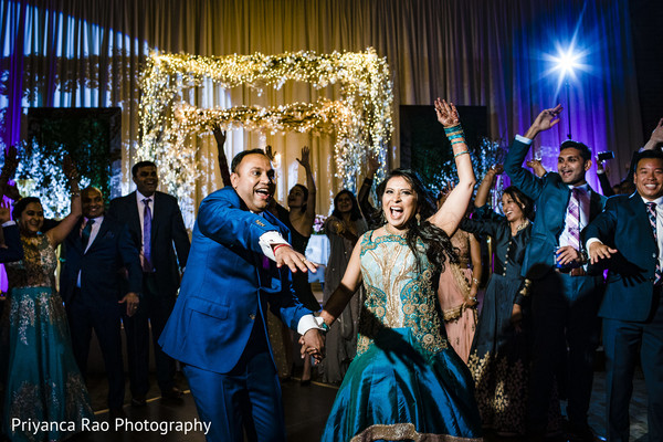 Indian bride and groom on the dance floor.