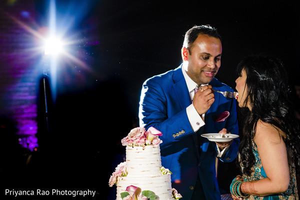 Raja and Maharani sharing a slice of cake.