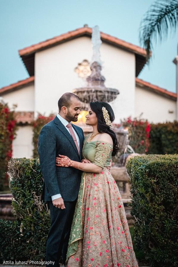 Maharani and her groom wearing formal wear.