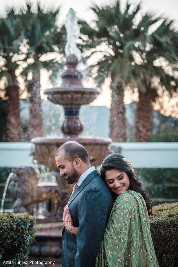 Indian bride hugging his Indian groom.
