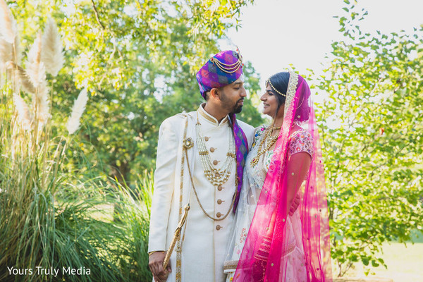 Indian groom and Indian bride sharing a moment in the garden