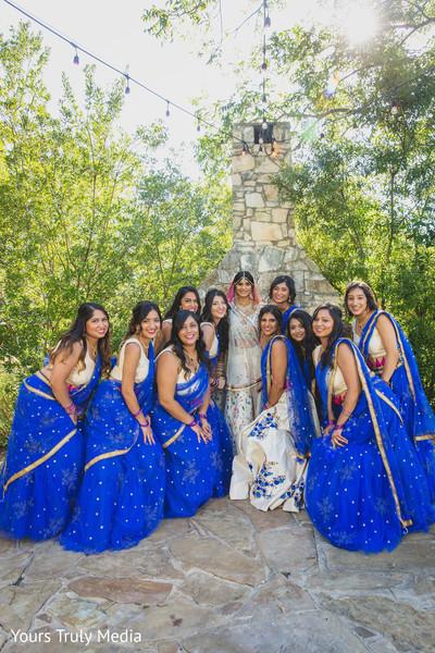 Maharani and her bridesmaids posing at the yard