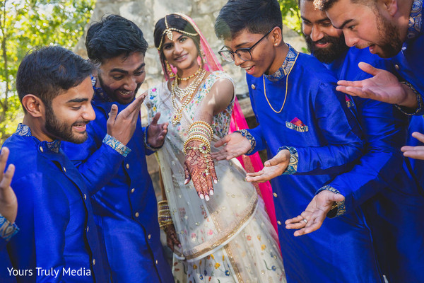 Maharani showing off her rings to the Indian groomsmen