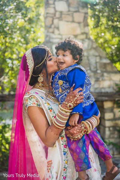 Maharani kissing and Indian kid on the cheek
