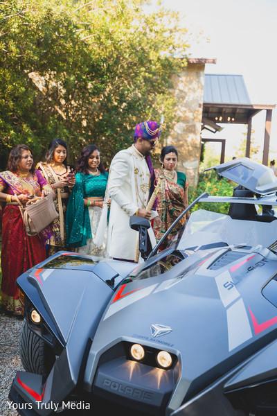 Indian groom getting into the Baraat car