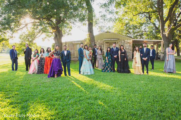 Newlywed Indian couple and their Indian wedding party posing