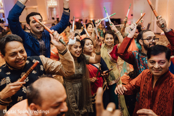 Indian relatives singing and dancing during the sangeet