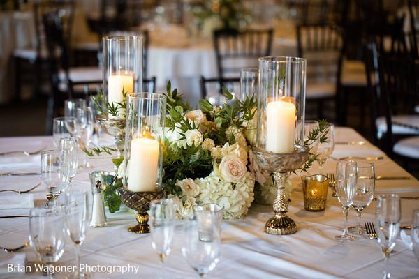 Indian wedding table white flowers centerpiece decor.
