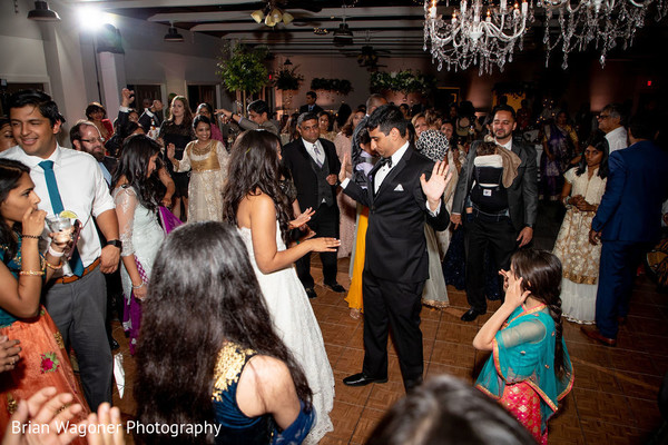Upbeat Indian wedding reception party.