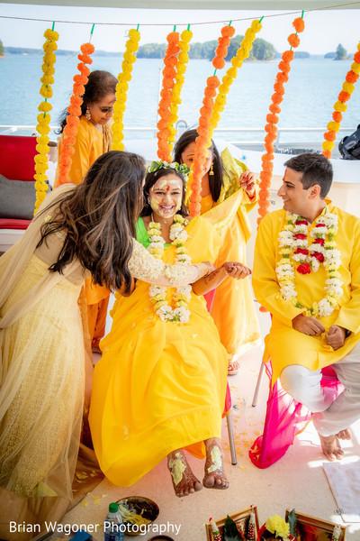 Indian bride with groom at haldi celebration.