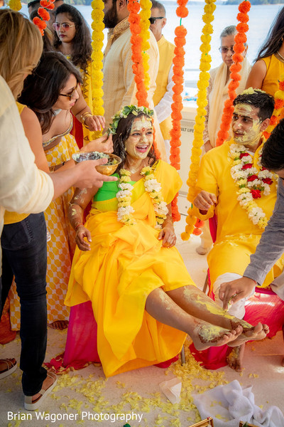 Indian couple all smeared with haldi photo.
