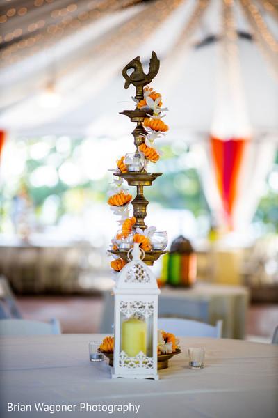 Sangeet white lantern with orange and white flowers table decor.