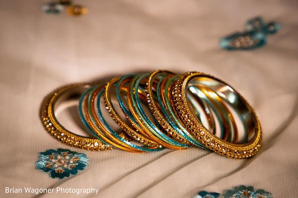 Golden, green and sky blue maharani's bangles.