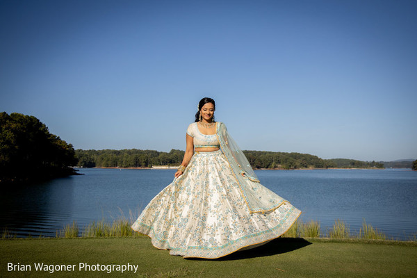 Cute indian bride on her white and light blue lehenga.