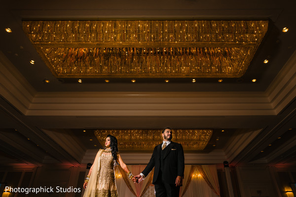 Maharani and Indian groom holding hands before the reception.