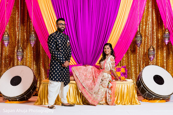 Indian groom standing besides his Indian bride.