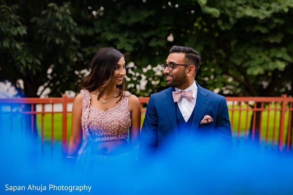 Indian couple looking at each other during photo session.