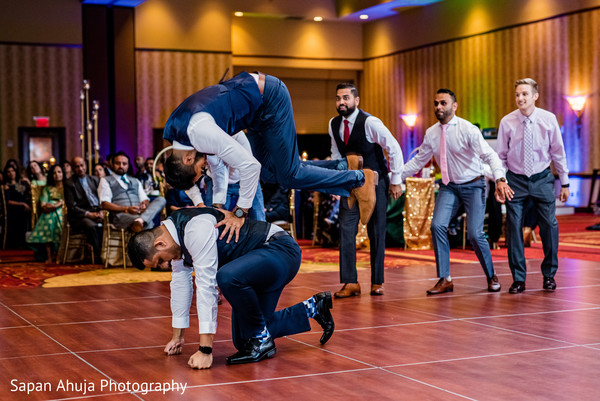 Indian groomsmen performing during the reception party.