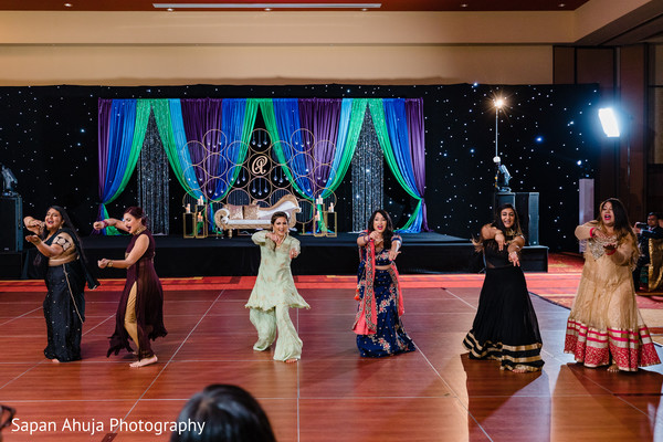Indian bridesmaids performing in the reception party.