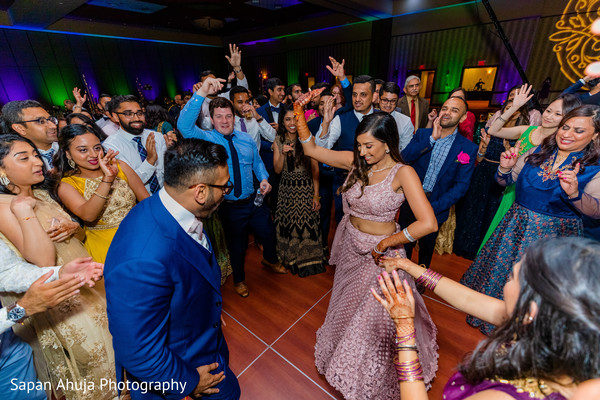 Indian couple dancing at the reception.