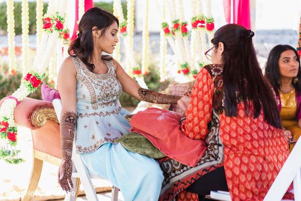 Indian bride getting her henna art done.