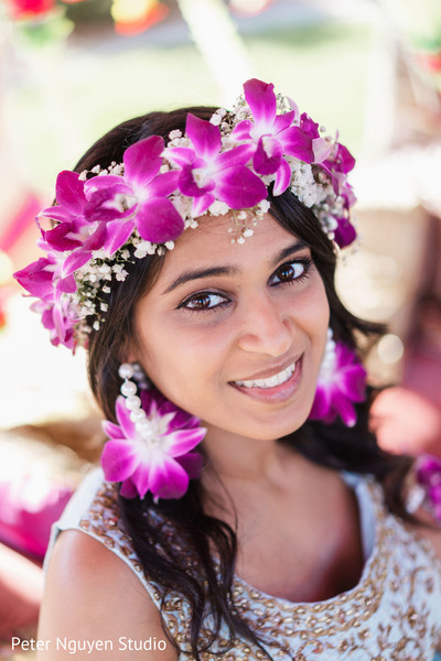 Indian bride with her flowers jewelry party fashion.