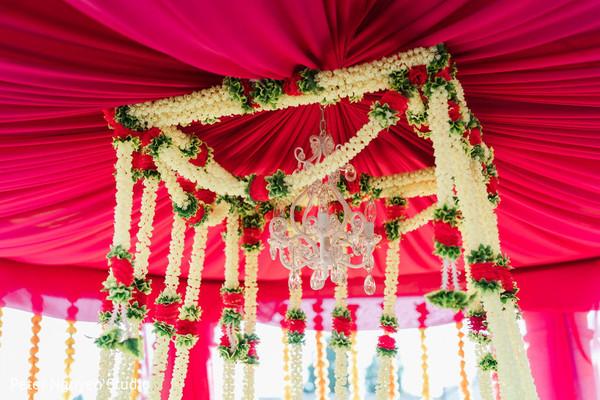 Mehndi party red mandap flowers decorations.
