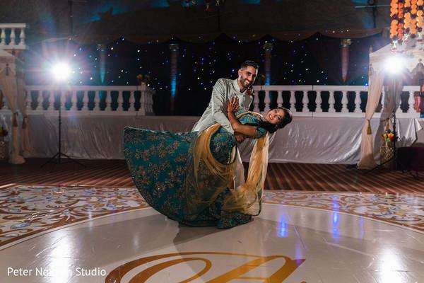 Indian couple at their sangeet dance floor.